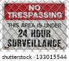 no trespassing sign  on the fence, warning about surveillance - stock photo
