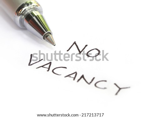 No vacancy written on a white paper with pen
