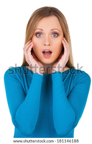 No way! Surprised young woman looking at camera and gesturing while standing isolated on white - stock photo