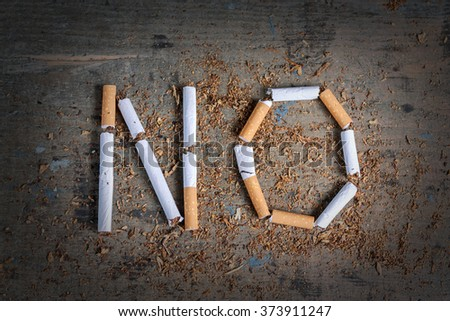 No word of a cigarette on a wooden surface. Antismoking background