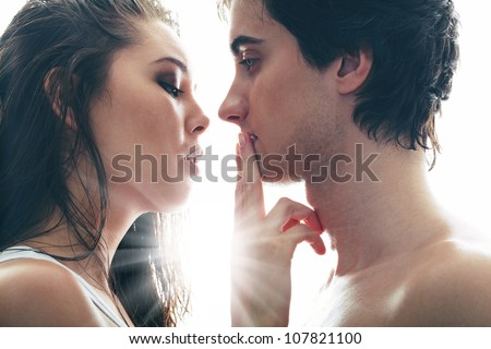No words being able to express the feelings of two young lovers - stock photo
