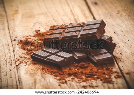 Noble dark chocolate on a wooden table in vintage style. - stock photo