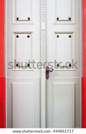 Noble frontdoor on red background
