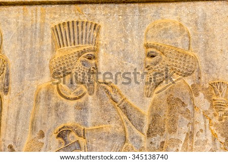 Noblemen relief detail on the stairway facade of the Apadana at the old city Persepolis. - stock photo