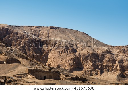 nobles tombs rocks. Mountain landscape of the city of death overlooking the tombs of Nobles n Luxor, Egypt. - stock photo