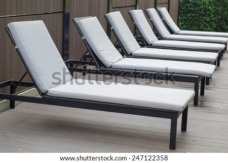 nobody on bed chair side pool