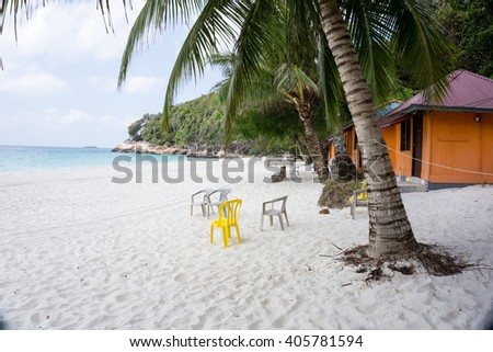 Nobody on the beauty beach with palm trees and house; - stock photo