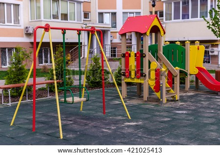 Nobody swing swinging in playground in the courtyard