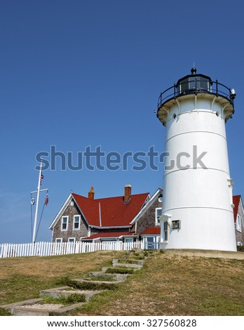 Nobska Light, also known as Nobska Point Light is a lighthouse located in Woods Hole on the southwestern tip of Cape Cod, Massachusetts.  - stock photo