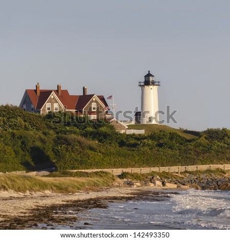 Nobska Lighthouse, Woods Hole, Falmouth, Cape Cod, Massachusetts USA seen from the beach. This landmark light house is a white cast-iron tower built in 1876. - stock photo