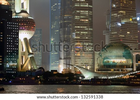 Nocturne view of modern Pudong district in Shanghai. With Oriental Pearl tower, Jin Mao tower and Financial tower. High iso. - stock photo