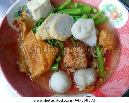 Noddles and fishball and morning glory and tofu with pink soup