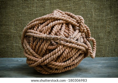 nodules of Brown rope on wood table