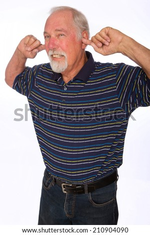 Noise is too loud for this mature man plugging his ears - stock photo