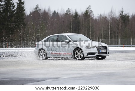 NOKIA, FINLAND - February 2, 2014: The Audi Quattro Tour 2014 test drive day in Nokia, Finland. Professional drivers were teaching how to drive safely in winter conditions on February 2, 2014. - stock photo