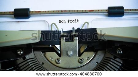 Non profit concept on typewriter  - stock photo