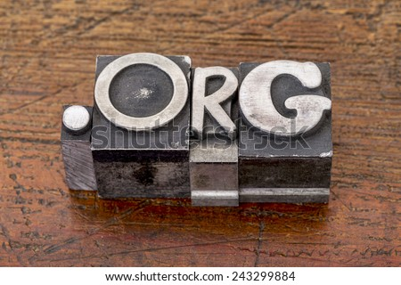non-profit organization internet  domain - dot org in mixed vintage metal type printing blocks over grunge wood - stock photo