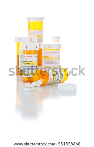 Non-Proprietary Medicine Prescription Bottles and Spilled Pills Isolated on a White Background. These are labels with fictitious information applied.