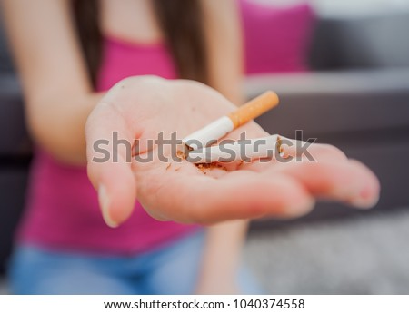 Non smoking, Female hands breaking cigarette, healthy lifestyle concept