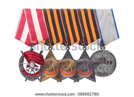 Nonexistent awards of the nonexistent country. Soviet military awards of times of World War II - Order of the Red Banner, Glory, Medal for Courage. It is isolated, the worker of paths is present. - stock photo