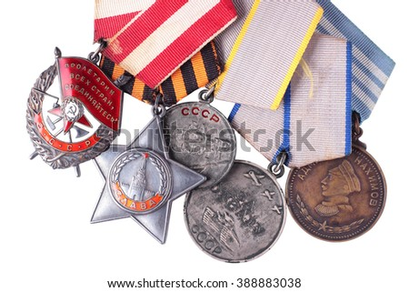 Nonexistent awards of the nonexistent country. Soviet military awards - Order Red Banner, Glory, Medal for Courage, Medal Battle Merit, Nakhimov Medal. It is isolated, the worker of paths is present. - stock photo