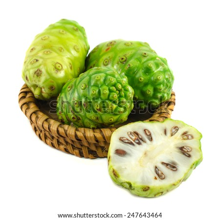 Noni in bamboo tray isolated on white background. - stock photo