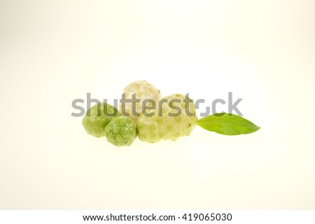 Noni or Morinda citrifolia, great morinda, Indian mulberry, beach mulberry, or cheese fruit on white background. - stock photo