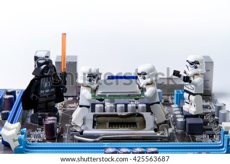 Nonthabure, Thailand - May, 05, 2016: Lego star wars repairing computer motherboard.The lego Star Wars mini figures from movie series.Lego is an interlocking brick system collected around the world.