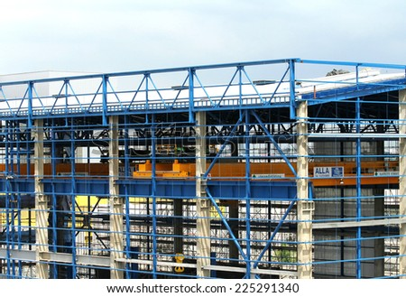 NONTHABURI - August 30: Construction workers natural gas combined cycle power plant building on August 30, 2014 in Nonthaburi, Thailand. The workers were building combined cycle power plant