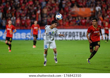NONTHABURI-FEB 8,Nguyen Hong Tien(W) of Hanoi T&T Jump tackles football during AFC Champions League 2014 between SCG Muangthong utd and Hanoi T&T at SCG Stadium on February8,2014 in Thailand
