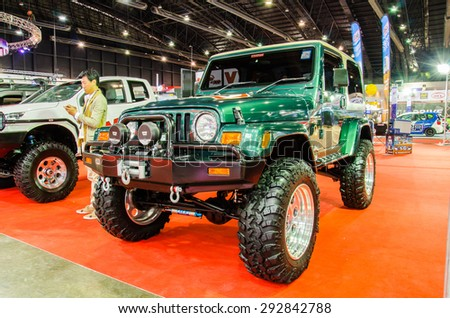 NONTHABURI - JUNE 24 : Jeep wrangler 4.0L Safari on display at Bangkok International Auto Salon 2015 is Exciting Modified Car Show on June 24, 2015 in Nonthaburi, Thailand. - stock photo