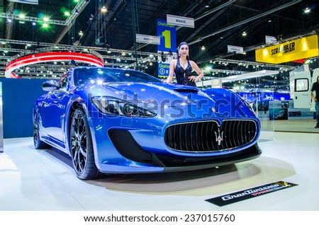 NONTHABURI - NOVEMBER 28:  Maserati GranTurismo MC Stradale with Unidentified model on display at Thailand International Motor Expo 2014 on November 28, 2014 in Nonthaburi, Thailand. - stock photo