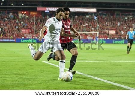 NONTHABURI THAI-FEB 21:Diogo Lu�s Santo (W) player of Buriram Utd. in action during Thai Premier League 2015 between SCG Muangthong Utd.and Buriram UTD.at SCG Stadium on February 21,2015 in,Thailand  - stock photo