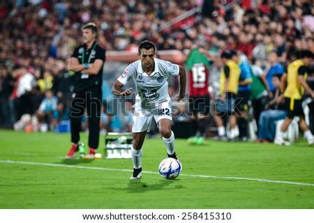 NONTHABURI THAI-FEB 21:Gilberto Macena of Buriram Utd.contols the ball during the Thai Premier League 2015 between SCG Muangthong UTD. and Buriram UTD.at SCG Stadium on February 21,2015 in,Thailand - stock photo