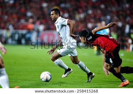 NONTHABURI THAI-FEB 21:Gilberto Macena(W) of Buriram Utd.contols the ball during the Thai Premier League 2015 between SCG Muangthong UTD. and Buriram UTD.at SCG Stadium on February 21,2015 in,Thailand - stock photo