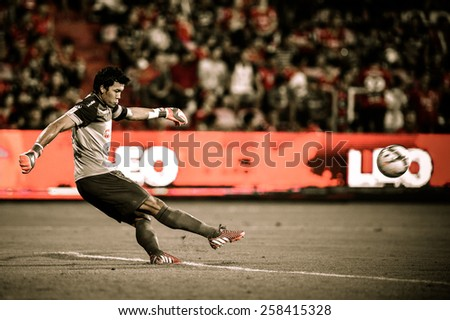 NONTHABURI THAI-FEB 21:Goalkeeper Kawin Thamsatchanan of Muangthong Utd.in action during Thai Premier League between SCG Muangthong UTD. and Buriram UTD.at SCG Stadium on February 21,2015 in,Thailand - stock photo
