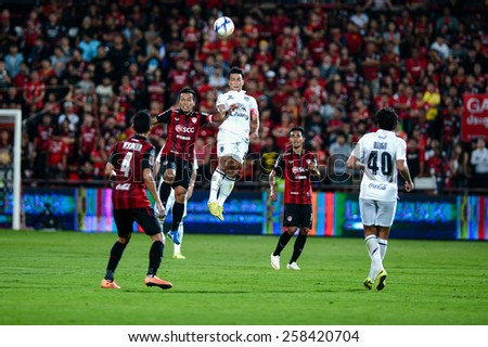 NONTHABURI THAI-FEB 21:Suchao Nutnum(W)of Buriram Utd.jumps for the ball during Thai Premier League 2015 between SCG Muangthong UTD. and Buriram UTD.at SCG Stadium on February 21,2015 in,Thailand - stock photo