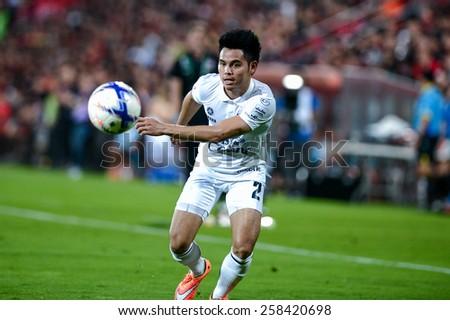 NONTHABURI THAI-FEB 21:Theerathon Bunmathan of Buriram Utd.eyes the ball during the Thai Premier League 2015 between SCG Muangthong UTD. and Buriram UTD.at SCG Stadium on February 21,2015 in,Thailand - stock photo