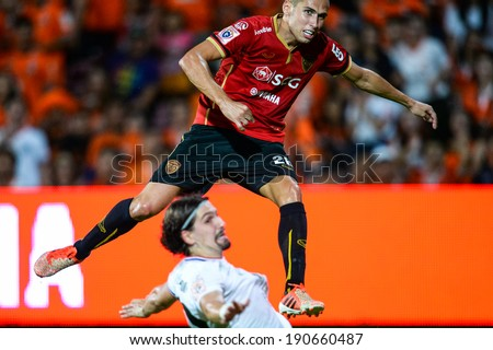 NONTHABURI THAILAND-APR19:Mario Gjurovski(Red)of Muangthong Utd.in action during  a Thai Premier League match between Muangthong Utd. and Chiangrai Utd.at SCG Stadium on April 19,2014,Thailand
