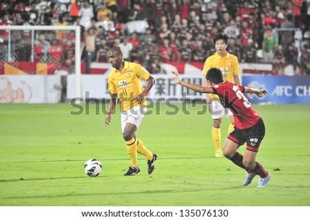 NONTHABURI, THAILAND- APRIL 9 : Luiz Guilherme (Y) in action during AFC Champions  League 2013 Between Muangthong Utd (R) VS Guangzhou Evergrande (Y) on April 9, 2013 at SCG Stadium, Bangkok,Thailand - stock photo