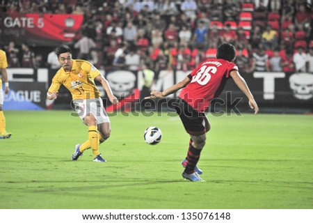 NONTHABURI, THAILAND- APRIL 9 : Zhao Xuri (Y) in action during AFC Champions  League 2013 Between Muangthong Utd (R) VS Guangzhou Evergrande (Y) on April 9, 2013 at SCG Stadium, Bangkok,Thailand - stock photo