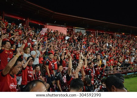 NONTHABURI THAILAND- AUG 9: Cheering fans in action during the Thai Premiel League 2015 beween MTUTD and BGFC at SCG Stadium on August 9, 2015 in Thailand.
