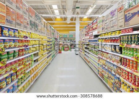 Nonthaburi, Thailand - August 22, 2015: Aisle view of a Tesco Lotus supermarket on August 22, 2015. Tesco is the world's second largest retailer with 6,531 stores worldwide. - stock photo
