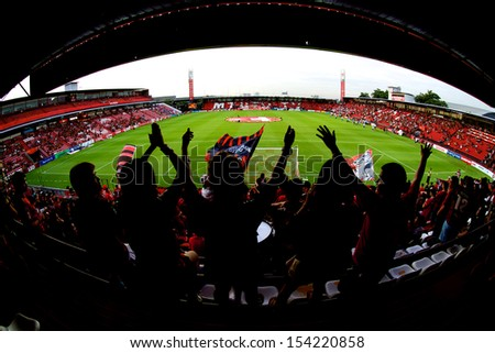 NONTHABURI THAILAND-AUGUST17:Unidentified fans SCG MuangThong utd.supporters during Thai Premier League between Muangthong Utd.and Pattaya United at SCG Stadium on Aug 17, 2013,Thailand - stock photo
