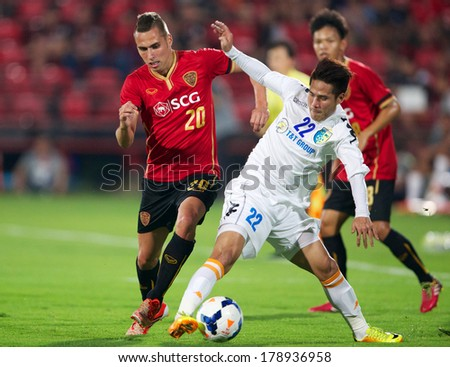 NONTHABURI-THAILAND FEB 8: Nguyen Quoc Long #22 (white)of Hanoi T&T in action during the AFC Champions League 2014 between Muangthong utd and Hanoi T&T at SCG Stadium on February 8, 2014 in Thailand