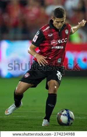 NONTHABURI THAILAND-FEBRUARY 21:Cleiton Silva of  Muangthong Utd.control the ball during Thai Premier League between Muangthong Utd.and Buriram United at SCG Stadium on Feb 21, 2015,Thailand - stock photo