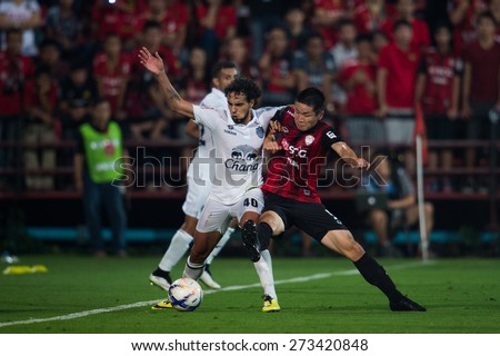 NONTHABURI THAILAND-FEBRUARY 21:	Diogo Luís Santo (white) of Buriram United in action during Thai Premier League between Muangthong Utd.and Buriram United at SCG Stadium on Feb 21, 2015,Thailand - stock photo