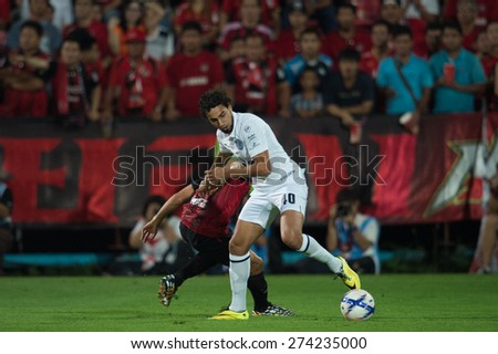 NONTHABURI THAILAND-FEBRUARY 21:Diogo Lu�­s Santo (white) of   Buriram United in action during Thai Premier League between Muangthong Utd.and Buriram United at SCG Stadium on Feb 21, 2015,Thailand - stock photo