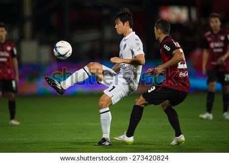 NONTHABURI THAILAND-FEBRUARY 21:	Go Seul-ki (L) of Buriram United in action during Thai Premier League between Muangthong Utd.and Buriram United at SCG Stadium on Feb 21, 2015,Thailand - stock photo