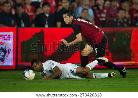 NONTHABURI THAILAND-FEBRUARY 21:	Naoki Aoyama  (R)of Muangthong utd. in action during Thai Premier League between Muangthong Utd.and Buriram United at SCG Stadium on Feb 21, 2015,Thailand - stock photo
